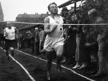 Adi was a keen athlete, seen here reaching the finish line in 1935