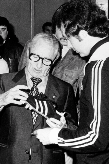 Adi Dassler exchanges views with athletes